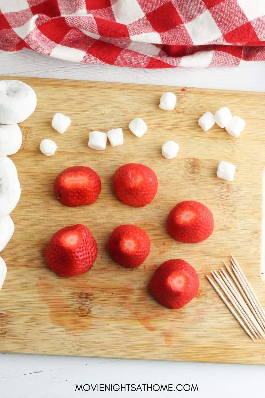 You'll need strawberries, mini marshmallows and mini powdered donuts