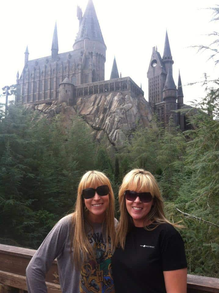 Kim and Kalee in front of Hogwarts at Universal Studios