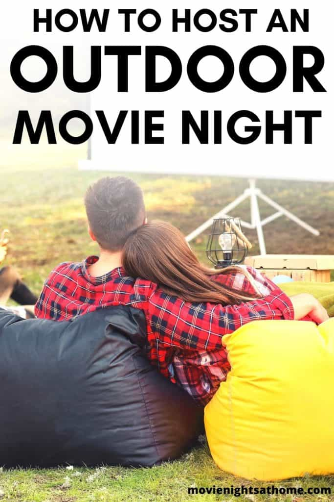 """Couple outside watching a movie at dusk - Text overlay """"How to Host an Outdoor Movie Night"""""""