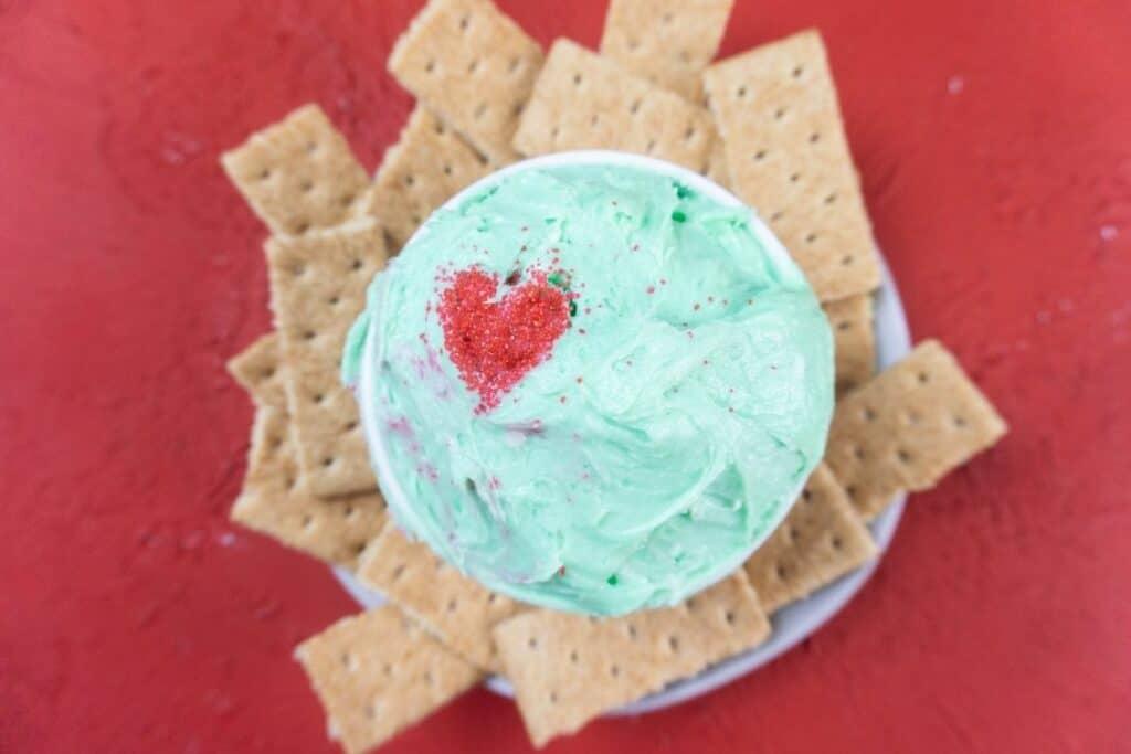 Grinch dip with graham crackers around it