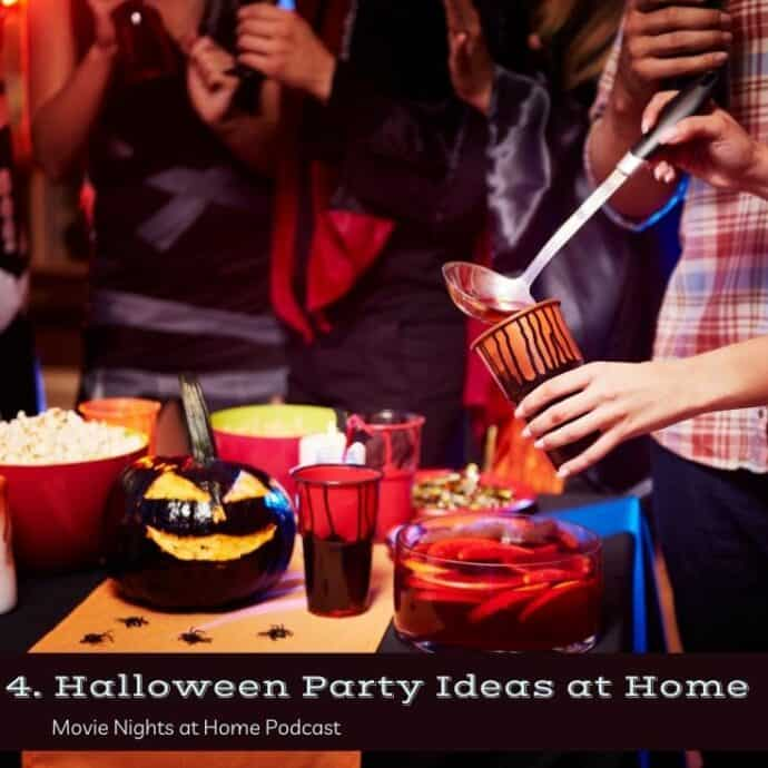 People serving themselves punch at Halloween Party